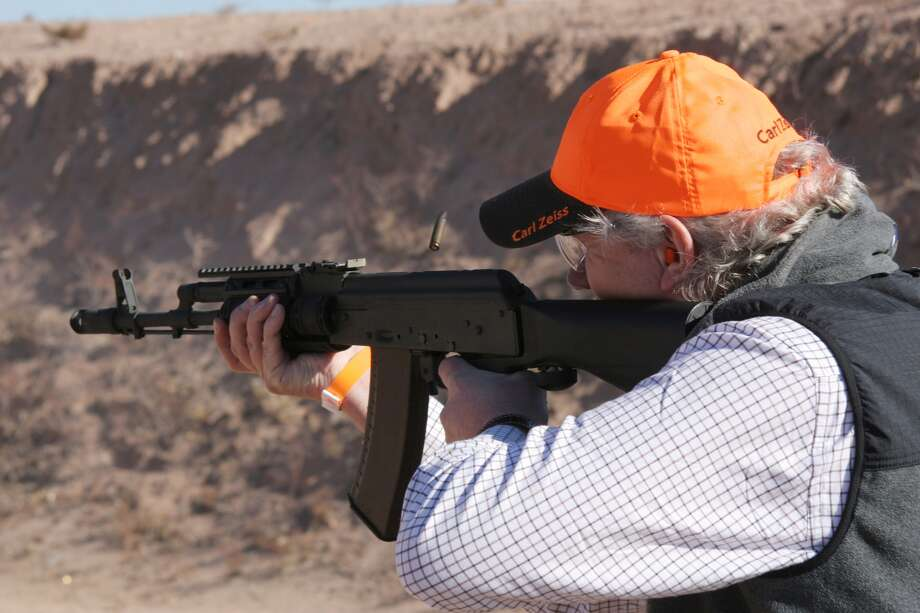 A man learns to use the Slidefire system at the SHOT Show 2012 media day. Photo: Fieldsports Channel