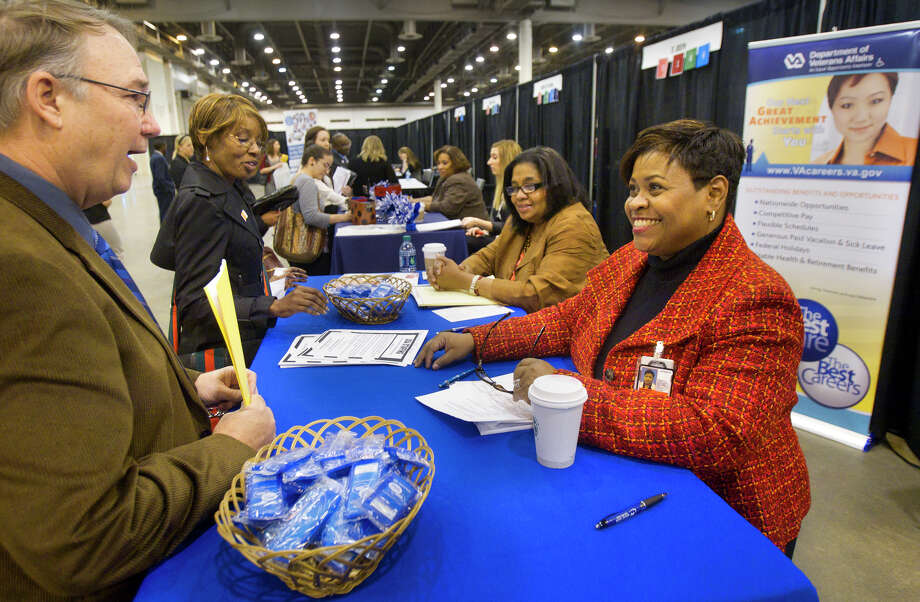 Russ Hyde, left, talks with Samantha Townsend, right, during the Chron Mega Job Fair at Reliant Center, Wednesday, Jan. 30, 2013, in Houston. Photo: Cody Duty, Houston Chronicle / © 2013 Houston Chronicle