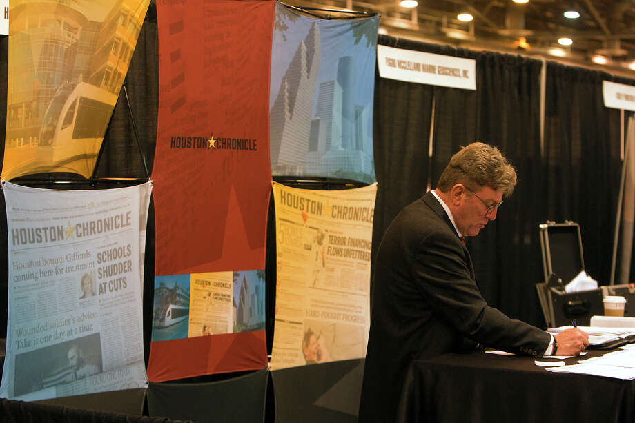 Vic Collins looks at paperwork during the Chron Mega Job Fair at Reliant Center, Wednesday, Jan. 30, 2013, in Houston. Photo: Cody Duty, Houston Chronicle / © 2013 Houston Chronicle
