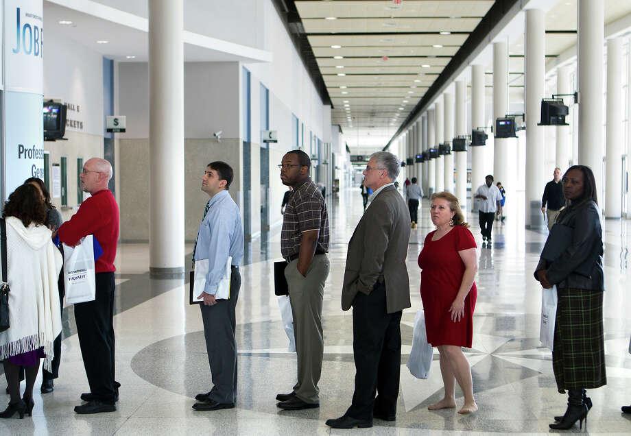 Applicants wait in line for the Chron Mega Job Fair at Reliant Center, Wednesday, Jan. 30, 2013, in Houston. Photo: Cody Duty, Houston Chronicle / © 2013 Houston Chronicle