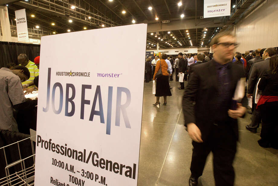 Applicants walk through the Chron Mega Job Fair at Reliant Center, Wednesday, Jan. 30, 2013, in Houston. Photo: Cody Duty, Houston Chronicle / © 2013 Houston Chronicle
