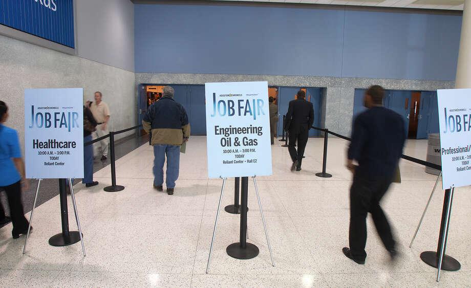 Applicants enter the Chron Mega Job Fair at Reliant Center, Wednesday, Jan. 30, 2013, in Houston. Photo: Cody Duty, Houston Chronicle / © 2013 Houston Chronicle