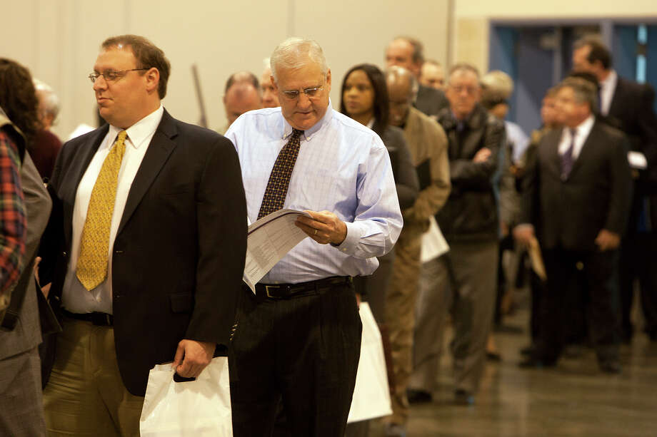 Applicants wait in line for the Chron Mega Job Fair at Reliant Center, Wednesday, Jan. 30, 2013, in Houston. Photo: Cody Duty, Houston Chronicle / © 2013 Houston Chronicle