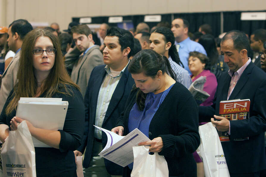 Applicants wait in line for the Chron Mega Job Fair at Reliant Center, Wednesday, Jan. 30, 2013, in
