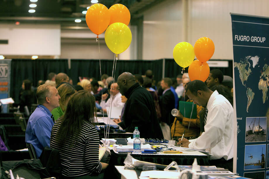An applicant fills out paperwork at the Chron Mega Job Fair at Reliant Center, Wednesday, Jan. 30, 2013, in Houston. Photo: Cody Duty, Houston Chronicle / © 2013 Houston Chronicle