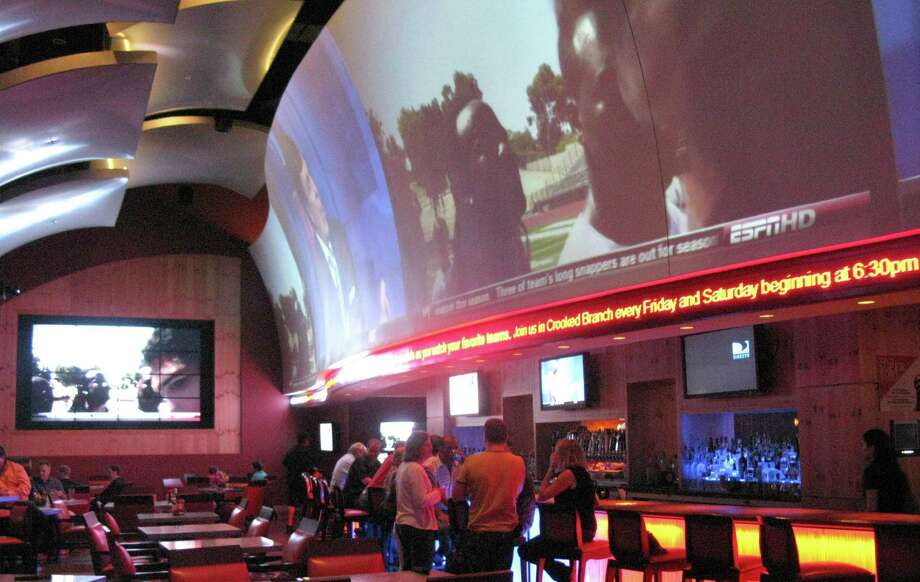 For an upscale setting: High Velocity Sports Bar, 23808 Resort Parkway at the JW Marriott San Antonio Hill Country Resort & Spa, 210-403-3434, www.highvelocitysa.com.A 120-foot high-def video wall could say all you need to know, but this is also most likely the swankiest place to take in a game. Good food, too. Photo: JENNIFER MCINNIS, SAN ANTONIO EXPRESS-NEWS / JMCINNIS@EXPRESS-NEWS.NET