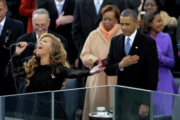 Beyoncé sings the national anthem at the ceremonial swearing-in of President Barack Obama at the U.S. Capitol during the 57th Presidential Inauguration in Washington, D.C. When the singer fidgeted with an in-ear monitor, she inadvertently revealed that she was aided by a prerecorded vocal track. Photo: Carolyn Kaster, Associated Press / AP
