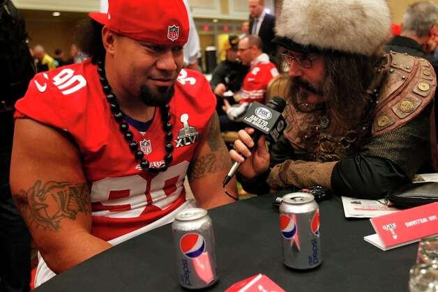 49er Isaac Sopoaga, 90 is interviewed by radio personality Vic The Brick Jacobs during the daily press conference for the San Francisco 49ers on Wednesday January 30, 2013 in New Orleans, La., as the two teams the Baltimore Ravens and the San Francisco 49ers prepare for this Sunday's NFL Superbowl game. Photo: Michael Macor, The Chronicle / ONLINE_YES