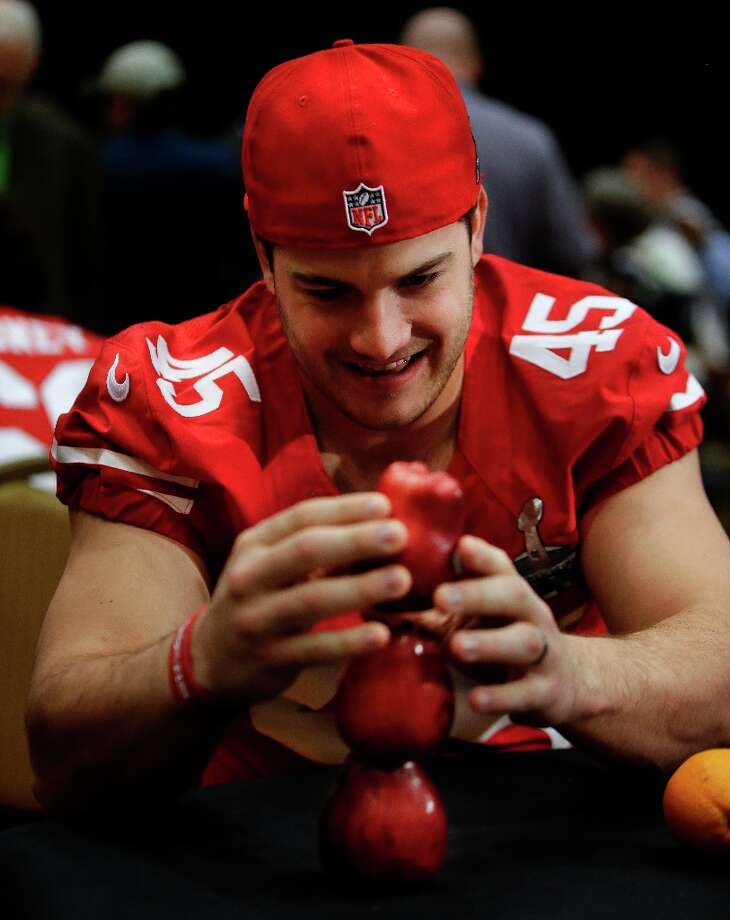 San Francisco 49ers practice squad linebacker Nate Stupar tries to balance apples while other players are interviewed during a media availability on Wednesday, Jan. 30, 2013, in New Orleans. The 49ers are scheduled to play the Baltimore Ravens in the NFL Super Bowl XLVII football game on Feb. 3. Photo: Mark Humphrey, Associated Press / AP