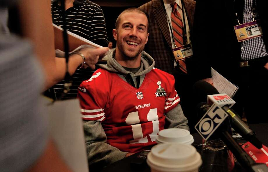 49er quarterback Alex Smith, 11, stays loose and smiles as he speaks with reporters during the daily press conference for the San Francisco 49ers on Wednesday January 30, 2013 in New Orleans, La., as the two teams the Baltimore Ravens and the San Francisco 49ers prepare for this Sunday's NFL Superbowl game. Photo: Michael Macor, The Chronicle / ONLINE_YES