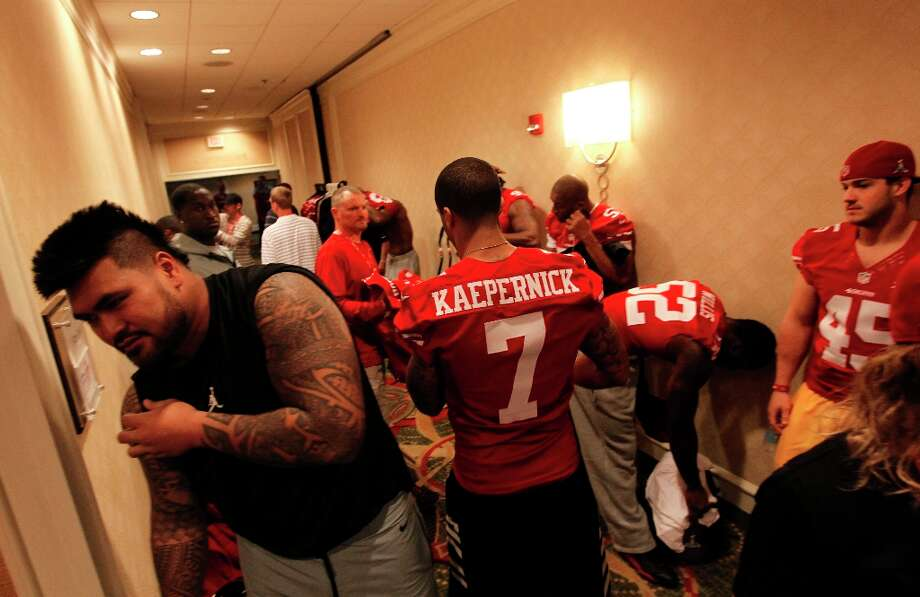 49ers including Mike Iupati, (left) and Colin Kaepernick get ready for the daily press conference for the San Francisco 49ers on Wednesday January 30, 2013 in New Orleans, La., as the Baltimore Ravens and the San Francisco 49ers prepare for this Sunday's NFL Superbowl game. Photo: Michael Macor, The Chronicle / ONLINE_YES