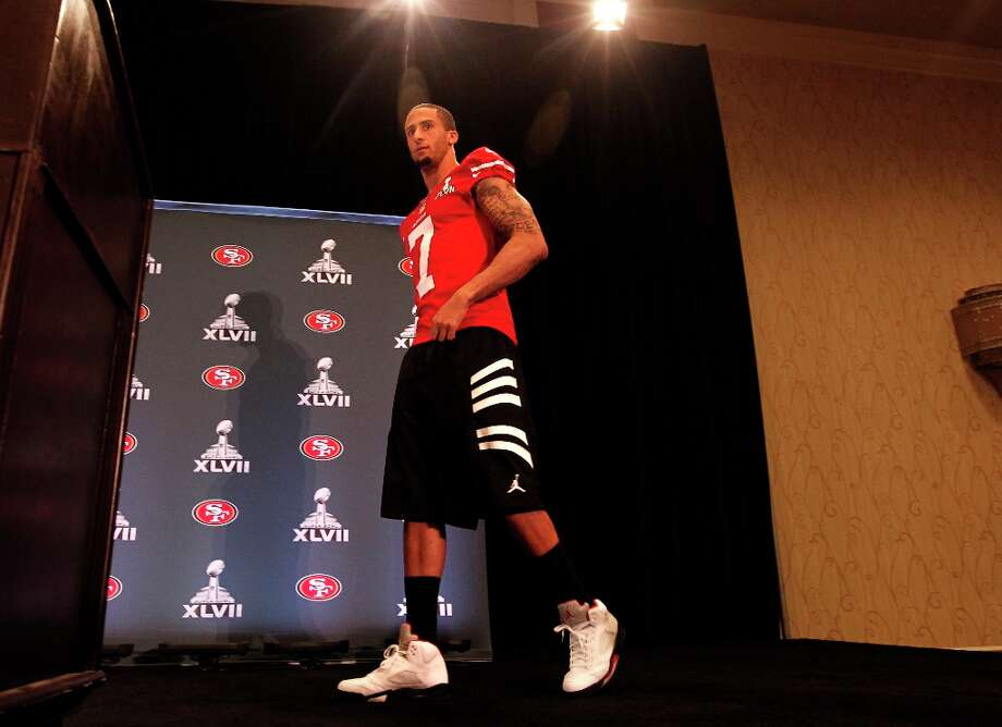 49er quarterback Colin Kaepernick, walks to the podium during the daily press conference for the San Francisco 49ers on Wednesday January 30, 2013 in New Orleans, La., as the Baltimore Ravens and the San Francisco 49ers prepare for this Sunday's NFL Superbowl game. Photo: Michael Macor, The Chronicle / ONLINE_YES