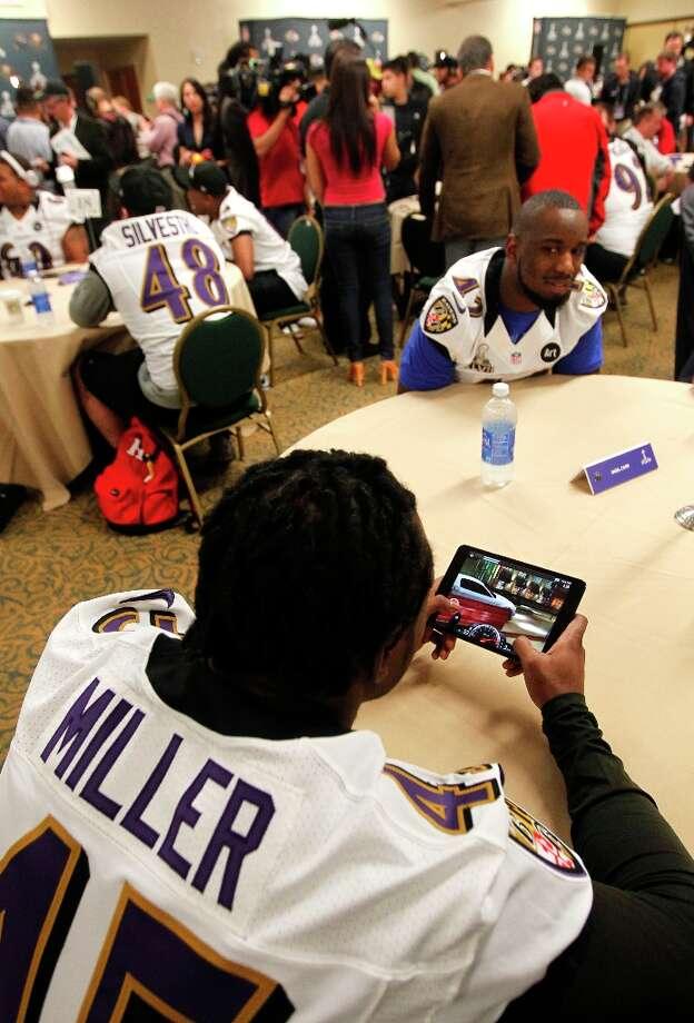 Ravens practice squad player Lonyae Miller, 45 keeps busy playing video games  during the daily press conference for the Baltimore Ravens on Wednesday January 30, 2013 in New Orleans, La., as the San Francisco 49ers and the Baltimore Ravens prepare for this Sunday's NFL Superbowl game. Photo: Michael Macor, The Chronicle / ONLINE_YES