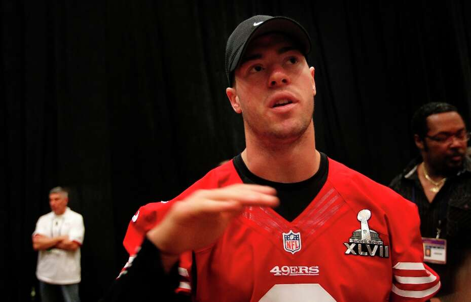 49er quarterback Scott Tolzien,3 talks with reporters during the daily press conference for the San