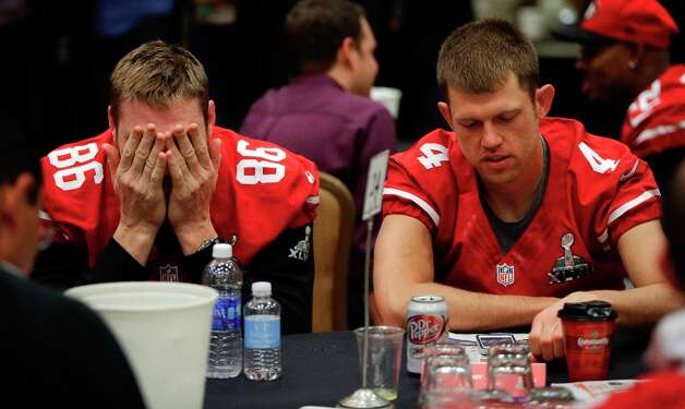 San Francisco 49ers long snapper Brian Jennings (86) and punter Andy Lee (4) wait to be interviewed during a media availability on Wednesday, Jan. 30, 2013, in New Orleans. The 49ers are scheduled to play the Baltimore Ravens in the NFL Super Bowl XLVII football game on Feb. 3. Photo: Mark Humphrey, Associated Press / AP