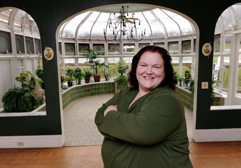 Becky Petro, 39, is the new executive director of Tarrywile Park.  She is photographed in the mansion's solarium Wednesday, January 30, 2013. Photo: Carol Kaliff / The News-Times