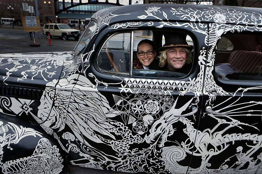 The art of driving:Jazmine Henderson and Link Wroltius cruise Eugene, Ore., in a 1939 Packard that they decorated by hand. Photo: Chris Pietsch, Associated Press