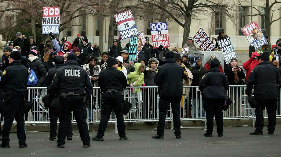 """Another few thousand people think it would be better to just revoke Westboro's tax exempt status, saying that """"by granting their tax exemption, we are funding their hate"""".(CLOSED: AWAITING RESPONSE) Photo: Chip Somodevilla/Getty Images, McClatchy-Tribune News Service / MCT"""