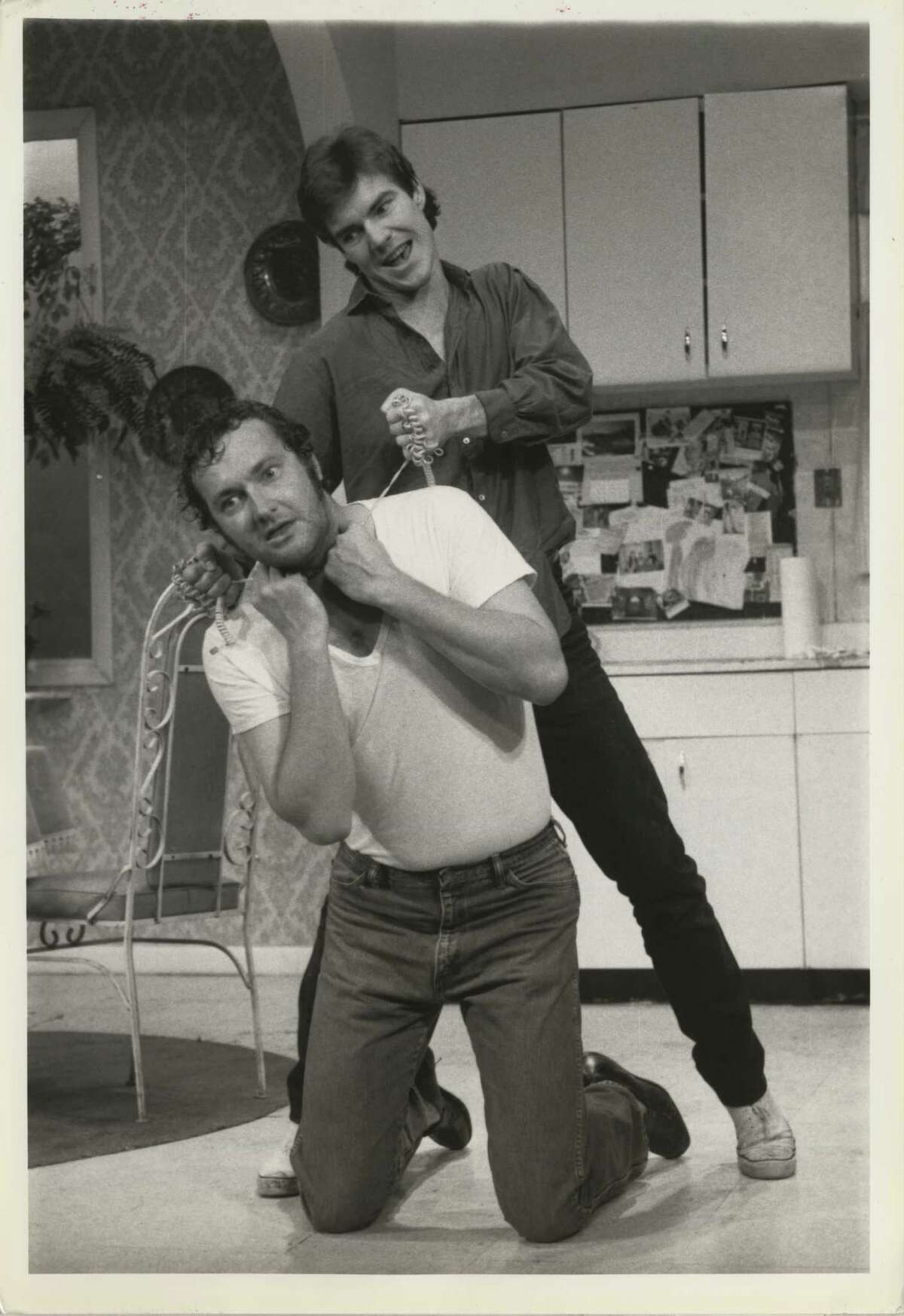Actors Dennis and Randy Quaid were born in Houston and grew up in Bellaire. Dennis went to the University of Houston. Here, Dennis attempts to strangle his kneeling brother Randy in the off-Broadway play
