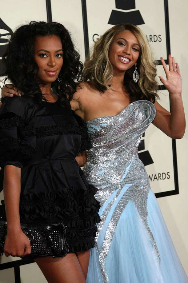 Beyonce Knowles (right) poses her with her younger sister Solange Knowles. Both musicians were born in Houston and return often. Photo: GABRIEL BOUYS, AFP/Getty Images / AFP