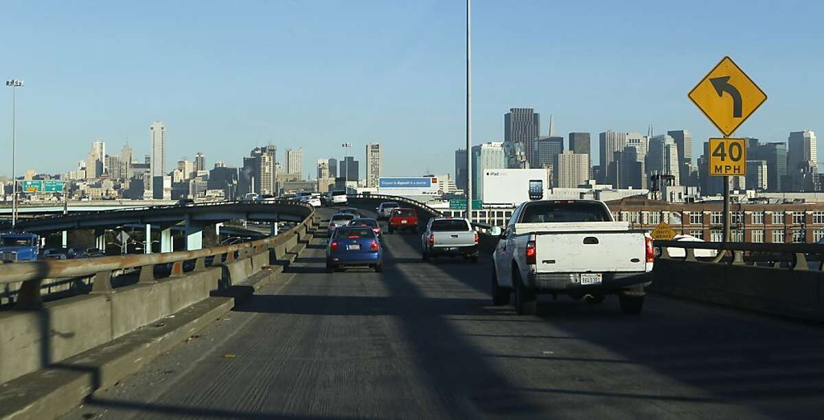 Commuters travel northbound on the Central Freeway where lane markers are barely visible in San Francisco, Calif. on Wednesday, Jan. 30, 2013.