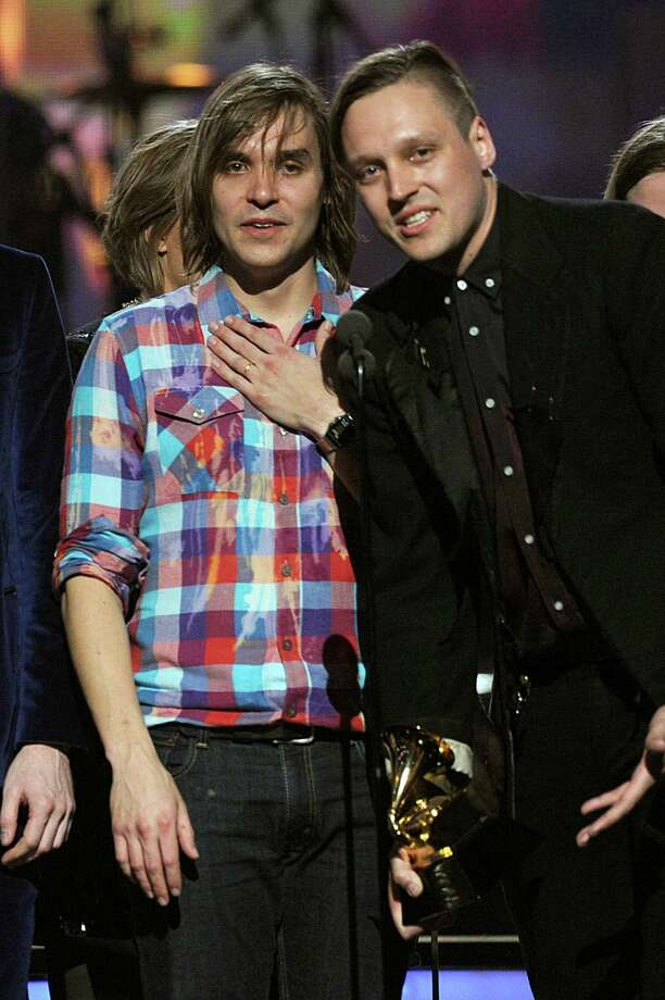 Musicians William, left, and Win Butler are in the indie rock band Arcade Fire. The brothers were raised in The Woodlands. Photo: Kevin Winter, Getty Images / Getty Images North America