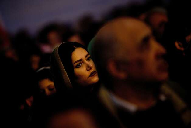 "Honoring fire: Iranian Zoroastrians watch a performance during the Sadeh festival in a Tehran suburb. The ancient Persian festival is celebrated by lighting a huge bonfire to defeat the forces of darkness and cold. Sadeh means ""hundred"" and refers to the 100 days and nights after the end of summer. Photo: Behrouz Mehri, AFP/Getty Images"