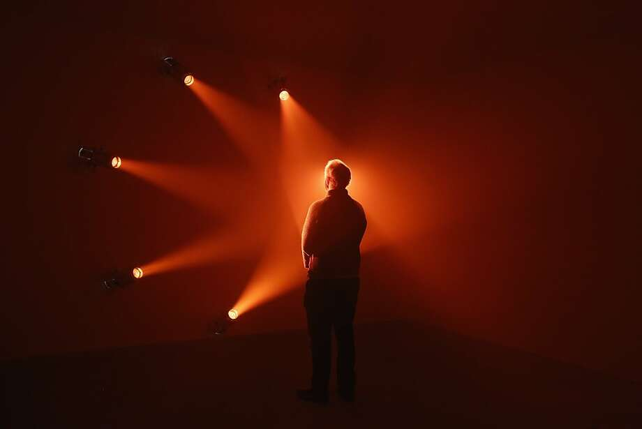 "'Rose' encounter: A man admires the art installation ""Rose"" by Ann Veronica Janssens at the Hayward Gallery's ""Light Show"" exhibition in London. Photo: Oli Scarff, Getty Images"
