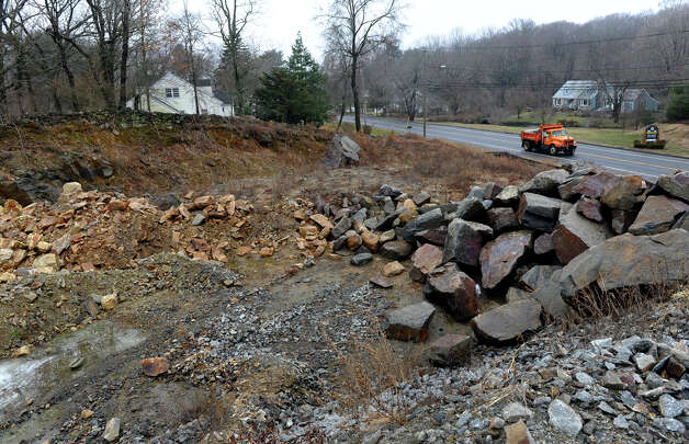 Large piles of rock sit on a empty lot where a proposed shopping center was to be built along Huntington Turnpike in Bridgeport, Conn. on Wednesday January 30, 2013. Photo: Christian Abraham / Connecticut Post