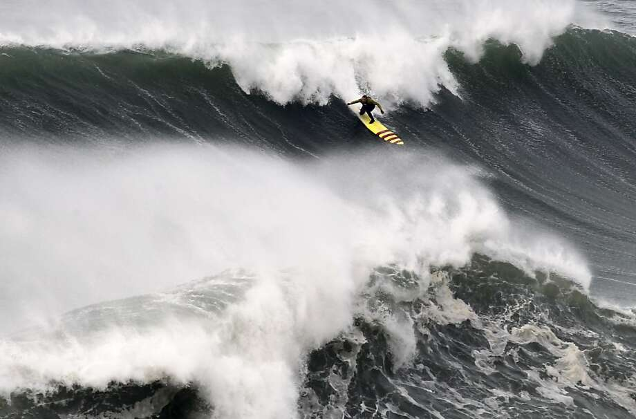 A 10-story wave? Hawaii's Garrett McNamara, here riding a massive swell at Praia do Norte beach in Nazare, Portugal, reportedly broke his own world record Monday for the largest wave ever surfed. The wave he caught is said to have been around 100 feet tall. The current record is 78 feet, also set at Nazare by McNamara. Photo: Francisco Seco, Associated Press
