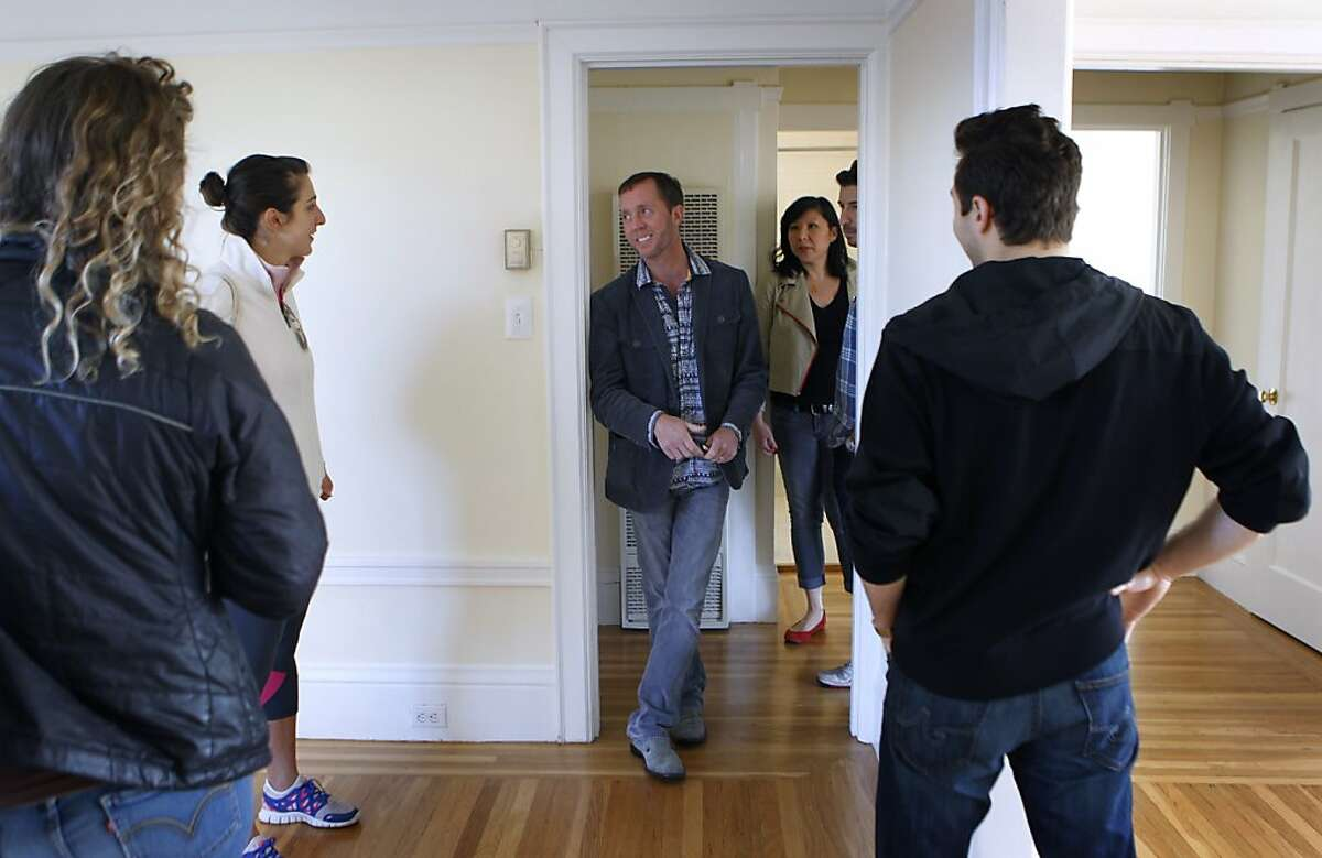 Listing agent Brian Brown (center) shows an apartment for rent to prospective tenants on Scott Street in San Francisco, Calif. on Saturday, Jan. 26, 2013. The one bedroom, one bath unit, located across the street from Alamo Square is available for $2950 a month.