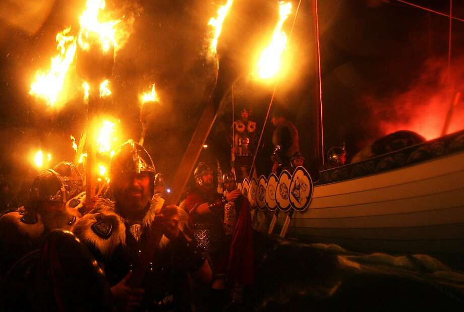 We have Burning Man, the Scots have Burning Boat:The Jarl Squad parades on the streets of Lerwick, Scotland, during the Up Helly Aa Viking festival. Every year a new Viking longboat is built and then, after a torchlight procession, burned on the water. Photo: David Cheskin, Associated Press