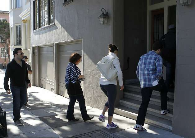 Prospective tenants head into an open house at a one-bedroom apartment on Scott Street in San Francisco, renting for $2,950. Photo: Paul Chinn, The Chronicle