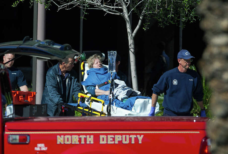 A woman is taken to a paramedic truck from an office building where a shooter opened fire in north central Phoenix on Wednesday, Jan. 30, 2013. (AP Photo/The Arizona Republic, Michael Schennum) Photo: Michael Schennum, Associated Press / The Republic