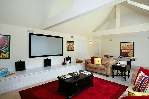 A media room is located on the top level. It features a large skylight and blackout blinds. Photo: Bob Morris Photography