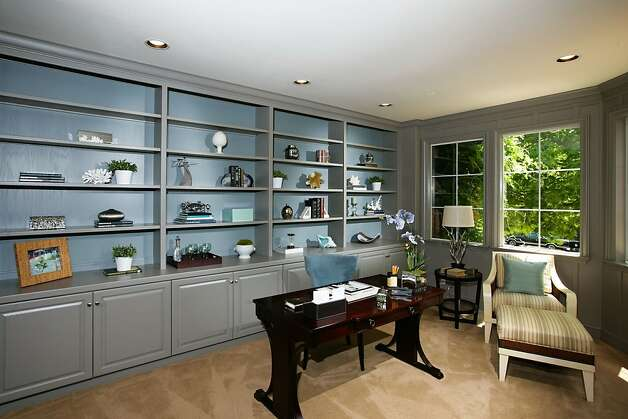 The office has built-in bookshelves and storage spaces throughout. Photo: Bob Morris Photography