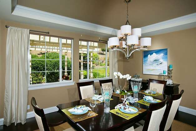 The dining room rests under a raised ceiling and looks out at the backyard. Photo: Bob Morris Photography