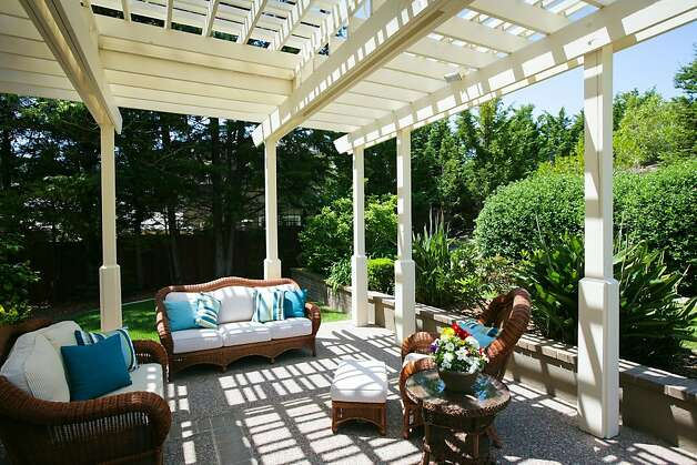An outdoor barbecue area is next to the enclosed pool. Photo: Bob Morris Photography