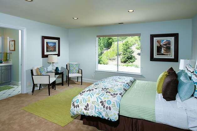The second master bedroom has vineyard views and a walk-in closet. Photo: Bob Morris Photography