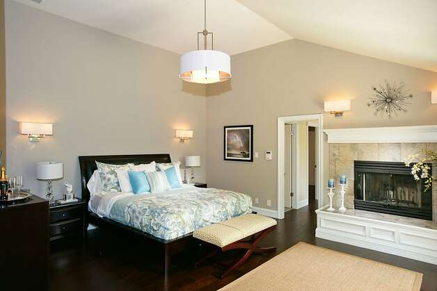 The master suite has a private deck, reading nook and fireplace. Photo: Bob Morris Photography