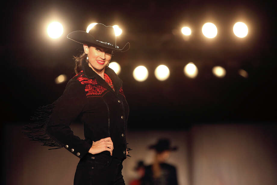 Michelle Mitchell models an outfit from Julian Gold during the Cowgirls Live Forever Fashion Show at the Pearl Stable in San Antonio on Thursday, Jan. 24, 2013. Photo: Lisa Krantz, San Antonio Express-News / © 2012 San Antonio Express-News