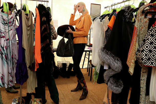 Model Irena Shyshkina gets ready for the Cowgirls Live Forever Fashion Show with fashions from Julian Gold at the Pearl Stable in San Antonio on Thursday, Jan. 24, 2013. Photo: Lisa Krantz, San Antonio Express-News / © 2012 San Antonio Express-News