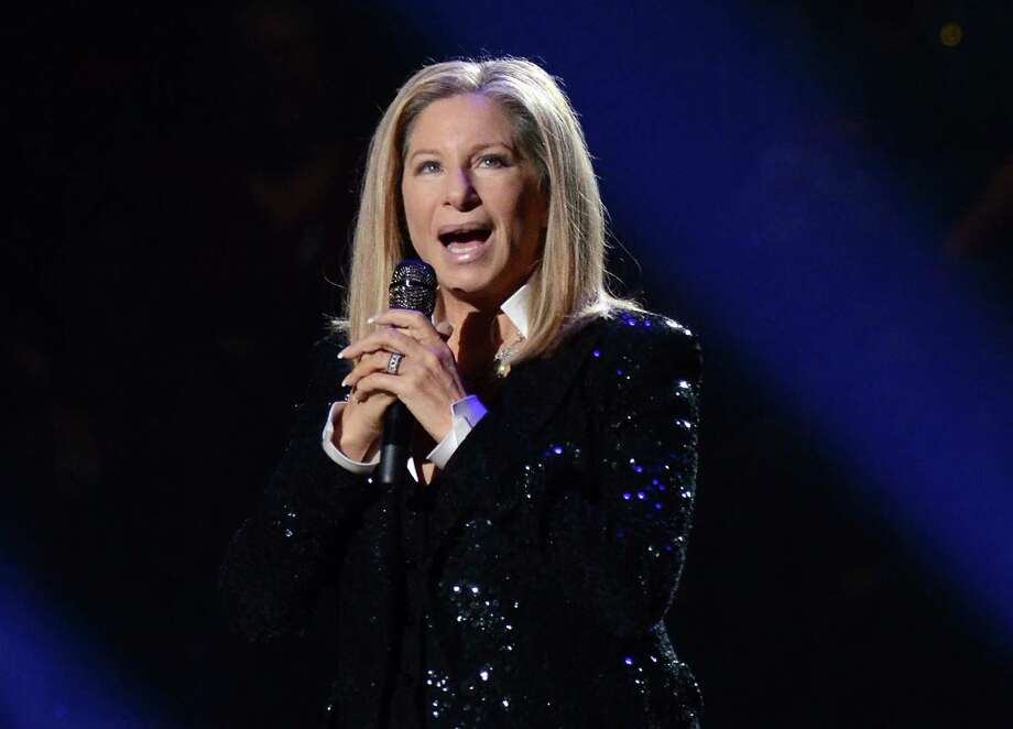 FILE - This Oct. 11, 2012 file photo shows singer Barbra Streisand performing at the Barclays Center in the Brooklyn borough of  New York. The Academy of Motion Picture Arts and Sciences announced Wednesday that the 70-year-old singing veteran will hit the stage on Feb. 24. It will be her second performance at the Oscars, and her first in 36 years. (Photo by Evan Agostini/Invision/AP, file) Photo: Evan Agostini