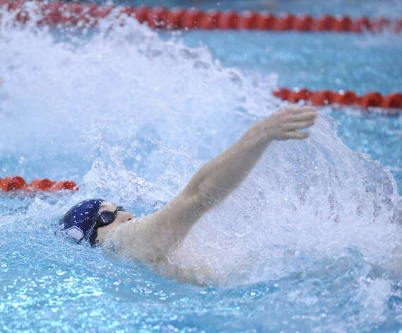 Max Wimer of Staples swims the backstroke leg during the 200 medley relay event in the boys high school swim meet between Greenwich High School and Staples High School at Greenwich, Wednesday, Jan. 30, 2013. Photo: Bob Luckey / Greenwich Time