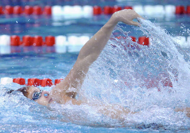 Alex Lewis of Greenwich swims the backstroke leg in the 200 medley relay in the boys high school swim meet between Greenwich High School and Staples High School at Greenwich, Wednesday, Jan. 30, 2013. Photo: Bob Luckey / Greenwich Time