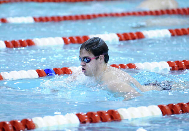 Iain Edmunson of Greenwich swims the breaststroke leg during the 200 medley relay event in the boys high school swim meet between Greenwich High School and Staples High School at Greenwich, Wednesday, Jan. 30, 2013. Photo: Bob Luckey / Greenwich Time