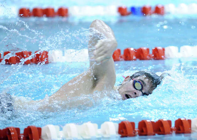 Iain Edmunson of Greenwich swims the freestyle leg in the 200 IM event during the boys high school swim meet between Greenwich High School and Staples High School at Greenwich, Wednesday, Jan. 30, 2013. Photo: Bob Luckey / Greenwich Time