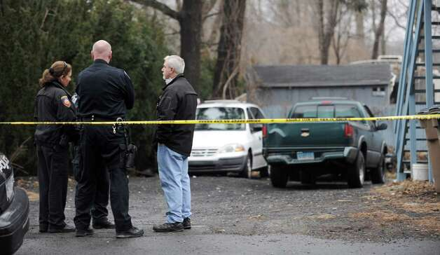 Police officers work at 172 Vine Road in Stamford on Wednesday, January 30, 2013. Photo: Lindsay Perry / Stamford Advocate