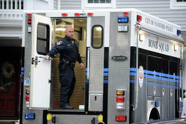 Police officers search the home of Donald Saturno at 172 Vine Road in Stamford on Wednesday, January 30, 2013. Saturno was arrested and charged with illegal bomb manufacture Sunday, March 10, 2013 after a traffic stop in Ridgefield. Photo: Lindsay Perry / Stamford Advocate