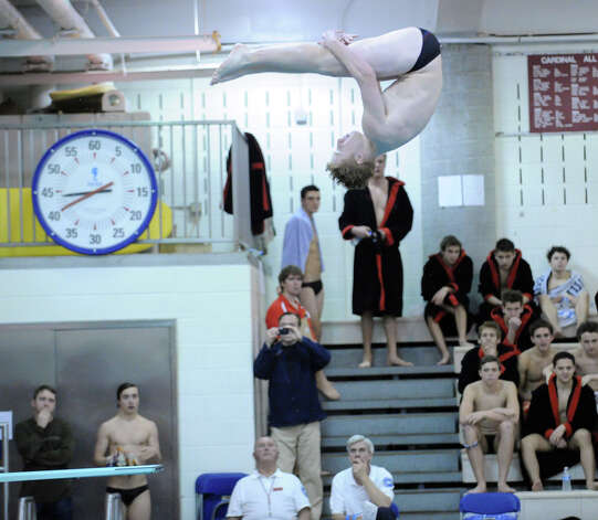 Greenwich High School diver Jeff Aselin soars above the GHS pool during the boys high school swim meet between Greenwich High School and Staples High School at Greenwich, Wednesday, Jan. 30, 2013. Photo: Bob Luckey / Greenwich Time